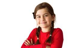 微笑对照相机的逗人喜爱的小女孩 免版税库存图片