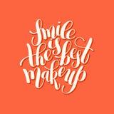 微笑是在正面qu上写字的最佳的构成手写的刷子 库存图片