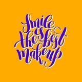 微笑是在正面qu上写字的最佳的构成手写的刷子 免版税库存照片