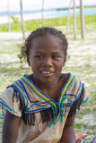 微笑有热带海滩背景的马达加斯加人的女孩画象 库存图片