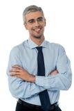 微笑的中部年迈的商人 免版税库存照片