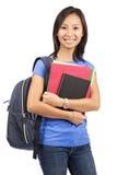 微笑的亚裔学生 免版税库存照片