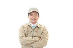 微笑的亚裔工作者 库存图片