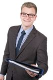 年轻微笑的人移交文件 免版税图库摄影