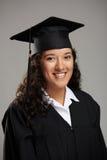 微笑的俏丽的西班牙学生女孩 免版税库存图片