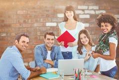 微笑的偶然同事的综合图象在会议 免版税库存照片