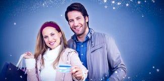 微笑的加上的综合图象显示信用卡的购物袋 免版税图库摄影