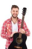 微笑的吉他演奏员 免版税库存图片