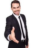 微笑的商人提供的握手画象  图库摄影