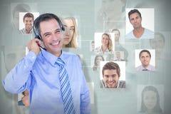 微笑的商人的综合图象使用耳机的 库存图片