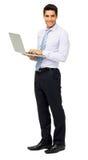 微笑的商人画象与膝上型计算机的 免版税库存图片