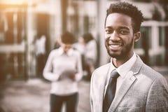 微笑的商人画象在办公室外 免版税图库摄影