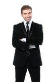 微笑的商人画象有横渡的胳膊的 免版税库存图片