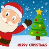 微笑的圣诞老人和贺卡 免版税库存图片