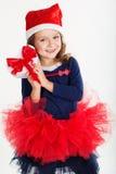 微笑的圣诞老人女孩拿着红色礼物盒 库存照片