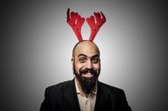 微笑的圣诞节有胡子的人 库存图片