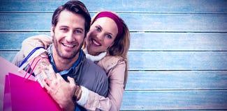 微笑的夫妇拥抱的综合图象 库存照片