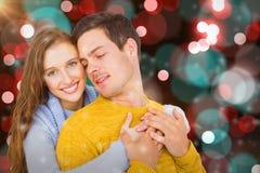 微笑的夫妇拥抱的综合图象 免版税库存图片