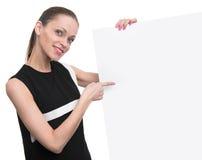 微笑的女商人举行空插件 库存图片