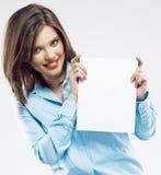 微笑的女商人显示标志的白色空插件 库存照片