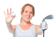 微笑的女孩在球和高尔夫俱乐部显示一台照相机 库存照片