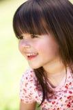 微笑的女孩室外纵向  免版税库存照片