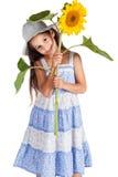 微笑的女孩用向日葵 库存图片