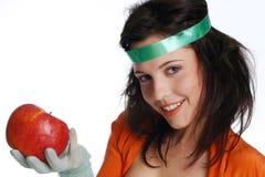 微笑的女孩用苹果 免版税图库摄影
