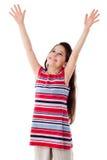 微笑的女孩用被举的手 图库摄影