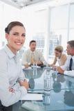 微笑的女实业家在会议 库存照片