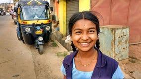 微笑的女小学生,印度画象  库存照片