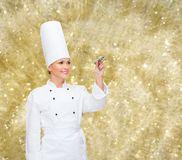 微笑的女性厨师文字某事在空气 库存照片