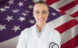 微笑的女性医生的综合图象有听诊器的在医院 图库摄影