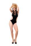 微笑的妇女佩带的泳装和毛皮盖帽 免版税图库摄影