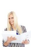 微笑的妇女在镶边衬衣藏品打开黏合剂 免版税库存照片