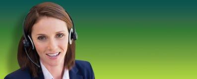 微笑的妇女特写镜头的综合图象谈话在话筒耳机 免版税图库摄影