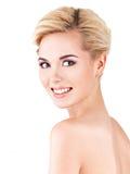 微笑的妇女的美丽的面孔有干净的新鲜的皮肤的 图库摄影