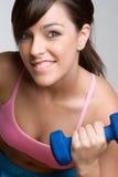 微笑的妇女锻炼 免版税图库摄影