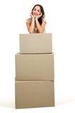 微笑的妇女画象有箱子的 库存图片