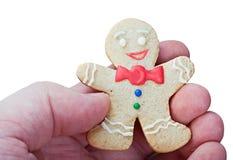 微笑的姜饼人在手上 免版税库存照片