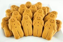 微笑的姜饼人曲奇饼板材  免版税库存图片
