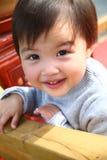 微笑的婴孩 库存照片