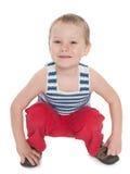 微笑的嬉戏的小男孩 免版税库存图片