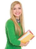 微笑的学员女孩纵向有书的 库存图片