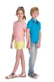微笑的孩子一起站立 免版税库存照片