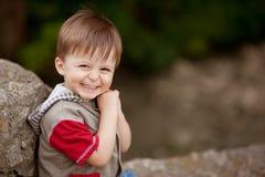 微笑的害羞的男孩 库存图片