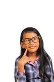微笑的小女孩认为和 免版税库存照片