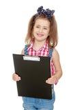微笑的小女孩阻止与纸的一个文件夹 库存图片