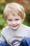 微笑的小孩的面孔 库存图片