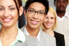 微笑的小组商人 免版税库存图片